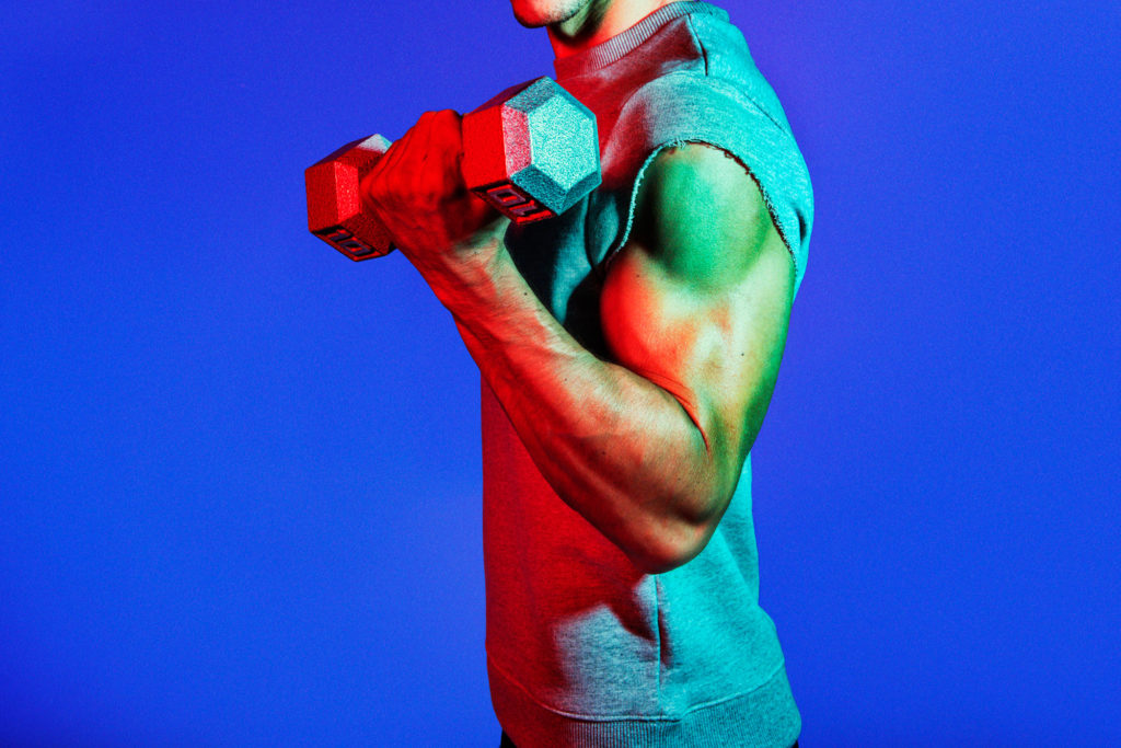 man holding fixed-weight dumbbell